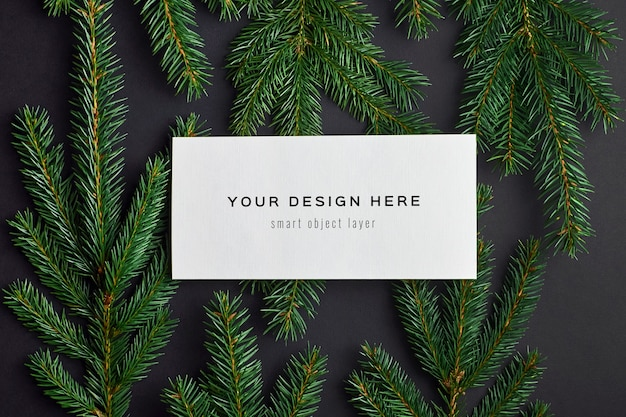 Christmas greeting card mockup with fir tree branches on black