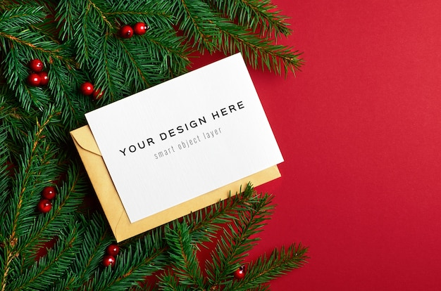 Christmas greeting card mockup with fir tree branches and holly berries on red
