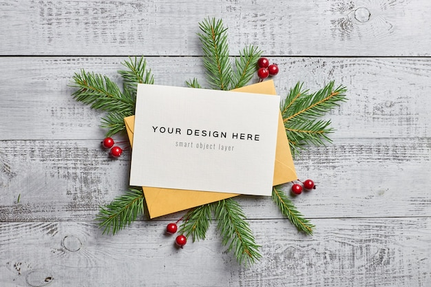 Christmas greeting card mockup with fir tree branches and holly berries