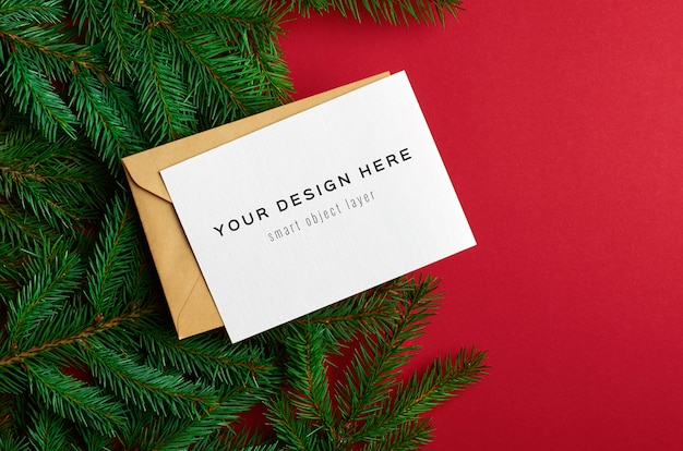 Christmas greeting card mockup with fir tree branches on red