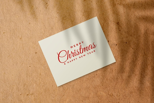 Christmas greeting card mockup with palm leaves shadow