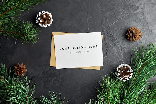 Christmas greeting card mockup with pine branches and cones