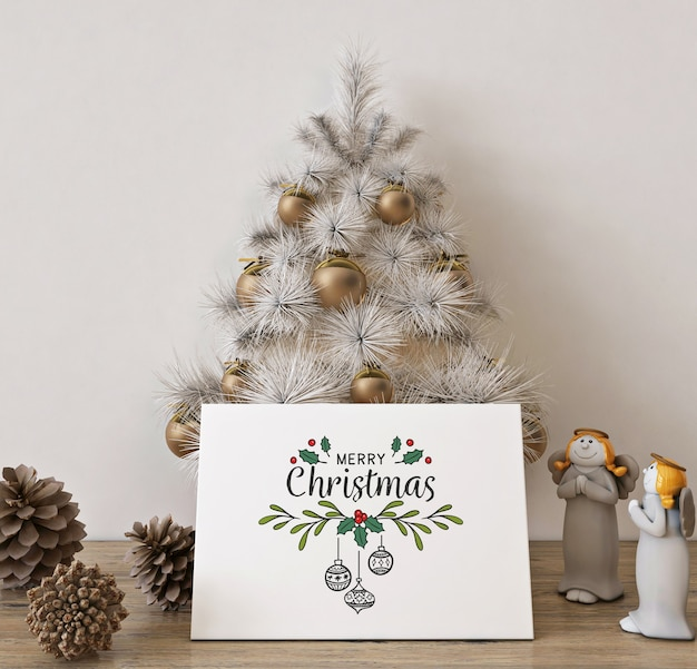 Christmas greeting card mockup with white christmas tree and decoration