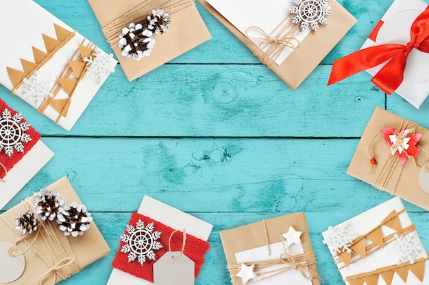 Christmas greeting card with gift boxes and cones, flatlay with copyspace