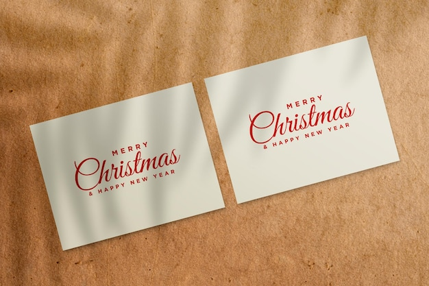 Christmas holiday greeting card design mockup with palm leaves shadow