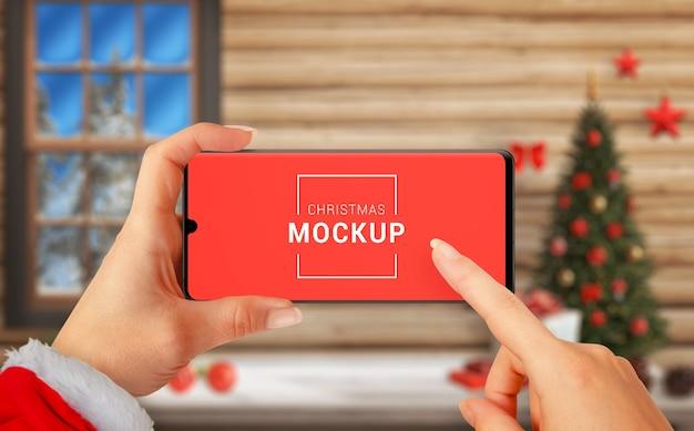 Christmas horizontal phone mockup in woman hands