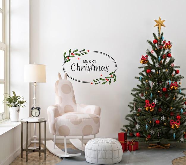 壁のモックアップとロッキングチェアのあるクリスマスのリビングルーム