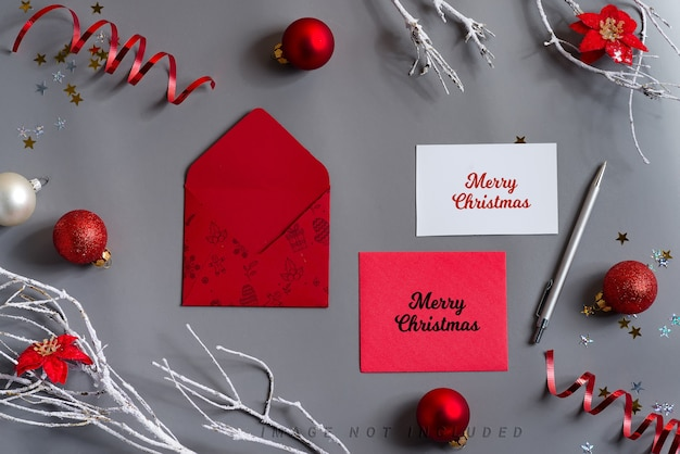 Christmas mockup cards with envelopes and holiday decoration.