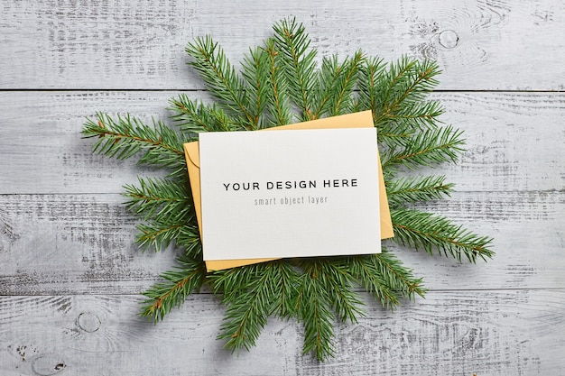 Christmas mockup composition with empty card and fir tree branches