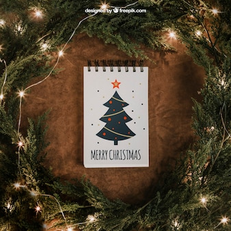 Christmas mockup with notepad and string lights