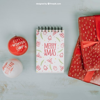 Christmas mockup with notepad and gift boxes