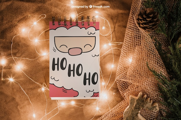 Christmas mockup with notepad and lights