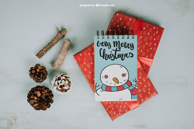 Christmas mockup with notepad and presents