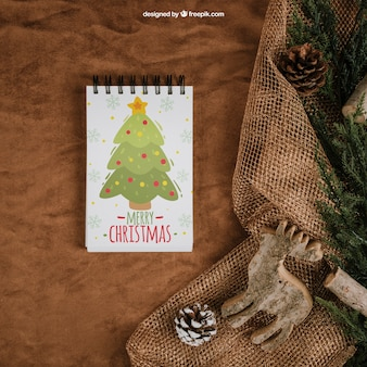 Christmas mockup with notepad on textile