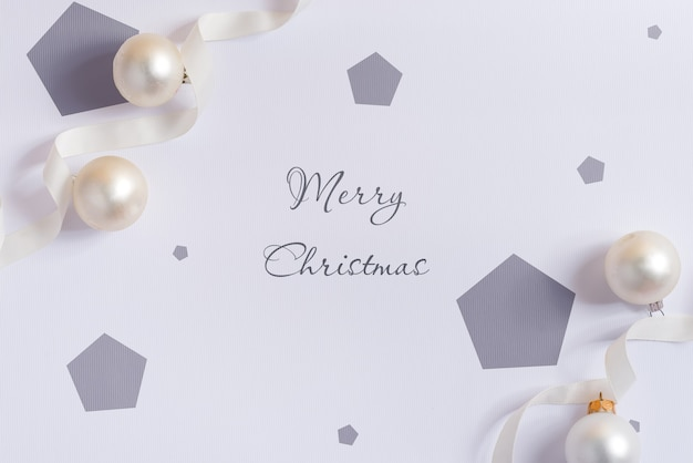 Christmas mockup with silver ribbon and decoration.