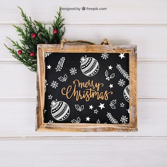 Christmas mockup with slate above mistletoe