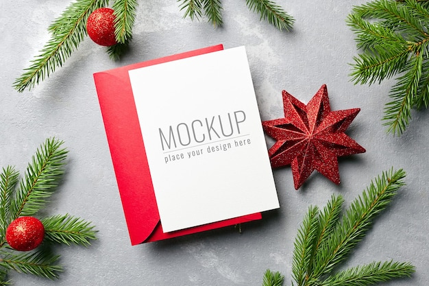 Christmas and new year greeting card mockup with red envelope and festive decorations