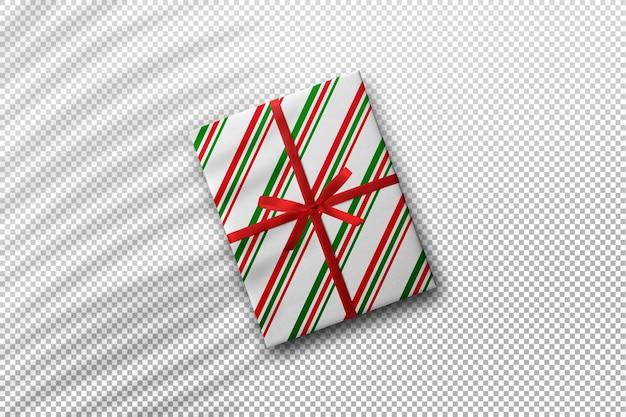 야자수 잎 그림자가 있는 크리스마스 선물 상자 모형