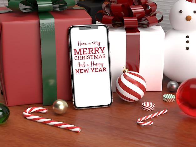 モバイルモックアップと装飾品でクリスマスのリアルなシーン