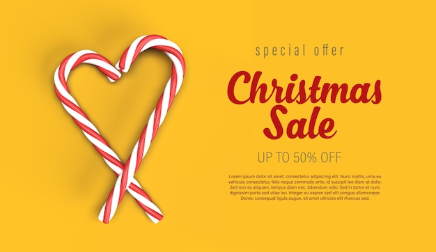 Christmas sale banner template with candy canes heart on yellow