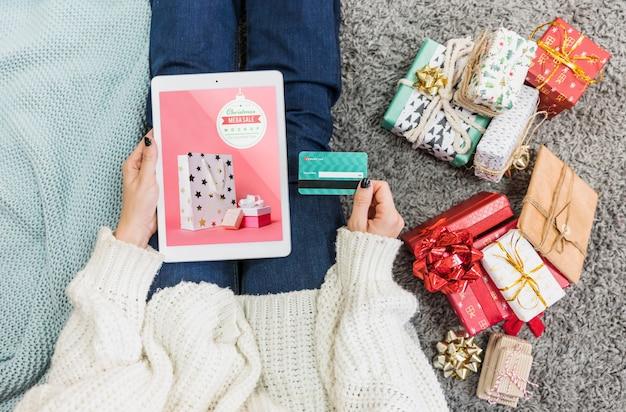 Christmas sale mockup with woman using tablet