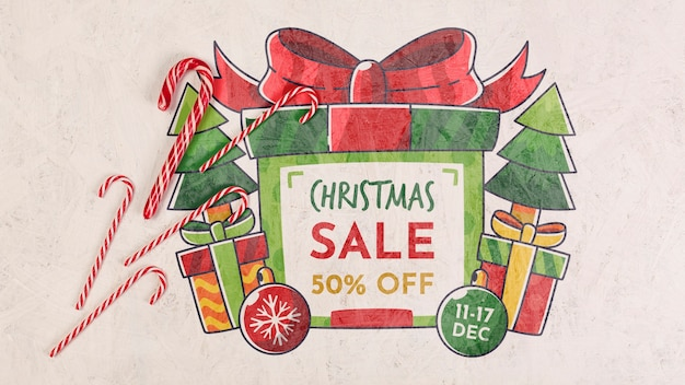 Christmas sale with a wrapped gift box and candies