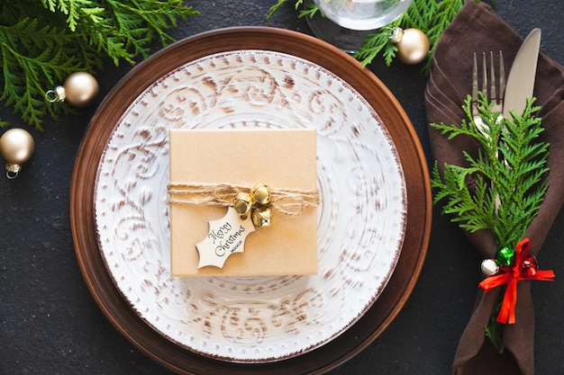 Christmas table setting with gift box. winter festive background. mockup