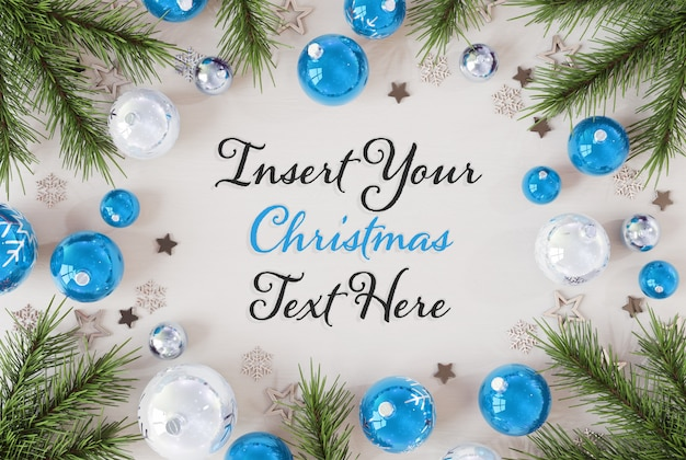 Christmas text on wooden surface with christmas ornaments mockup