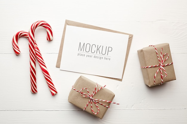 Christmas wish card mockup with gift boxes and candy canes