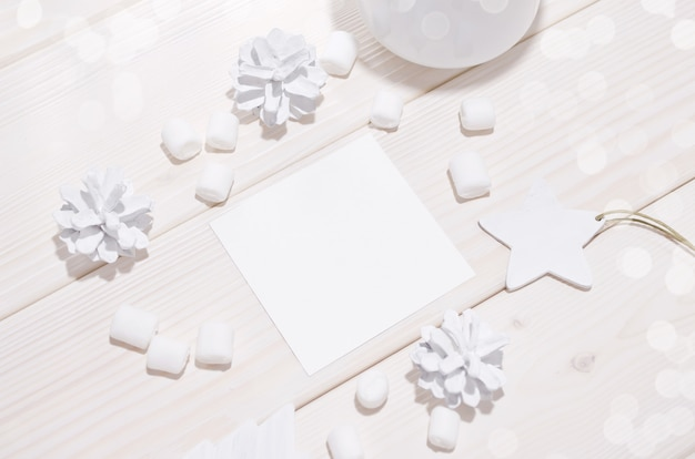 Christmas with square card mockup and white decorations on  wood table