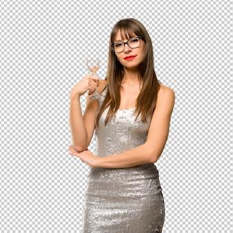 クリスマスの休日。新しい年20を祝うシャンパンとスパンコールドレスを着ている女性