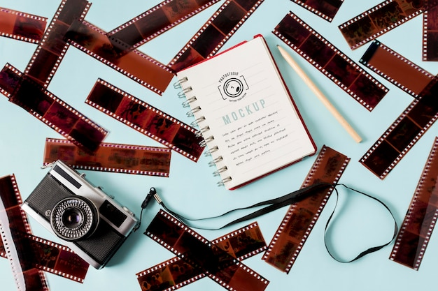 Cinema film rolls with notebook