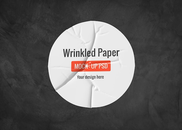 Circle wrinkled paper mockup on a dark surface
