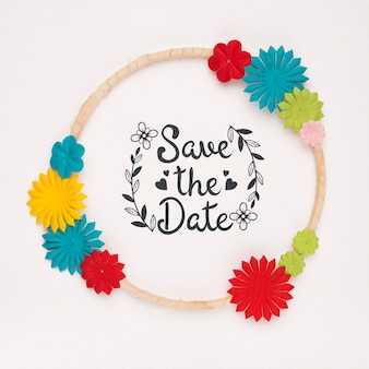 Circular frame with colourful flowers save the date mock-up