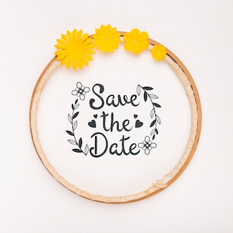 Circular frame with yellow flowers save the date mock-up