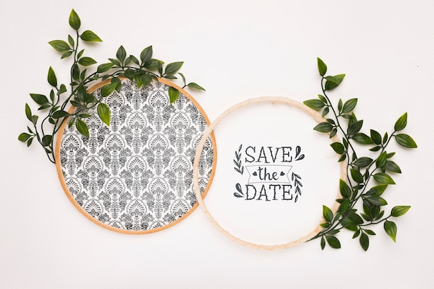 Circular frames with leaves save the date mock-up