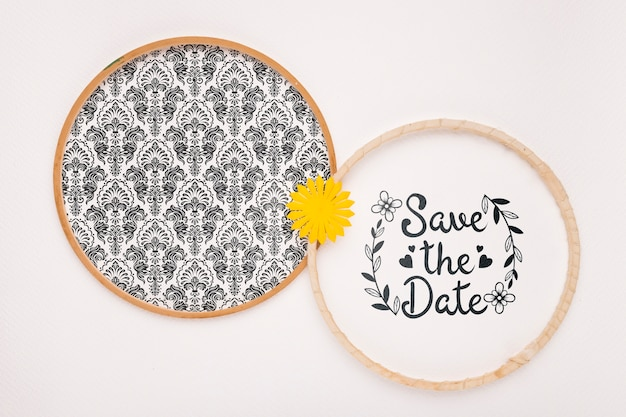 Circular frames with yellow flower save the date mock-up