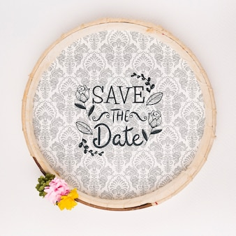 Circular vintage frame with flowers save the date mock-up