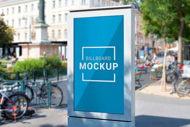 City light billboard mockup. modern led display in white case on city street