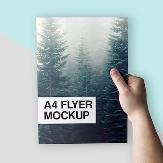 Clean A4 Flyer In Hand Mockup