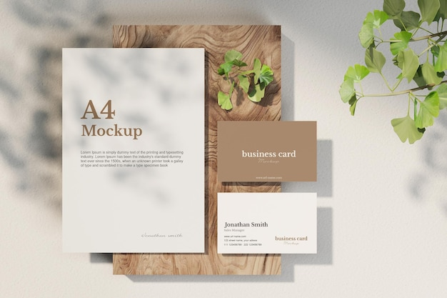 Clean a4 paper and minimal business card mockup on wood small plate