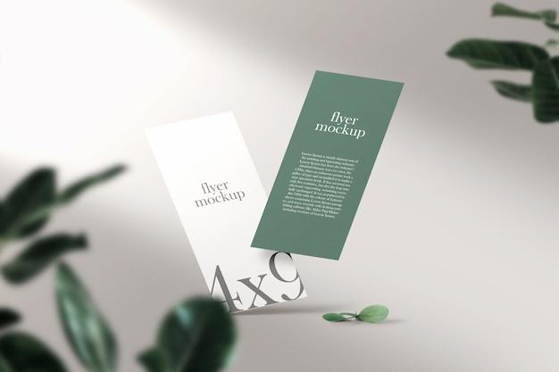 Volantino opuscolo pulito minimale che galleggia sullo sfondo superiore con foglie. file psd.