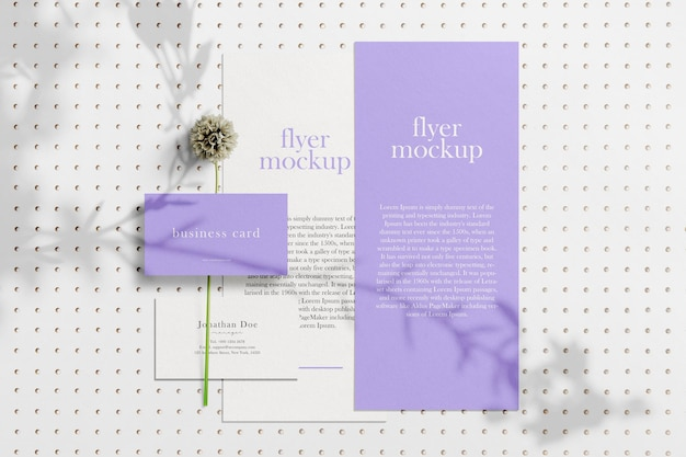 Clean minimal business card and flyer mockup on background with flower