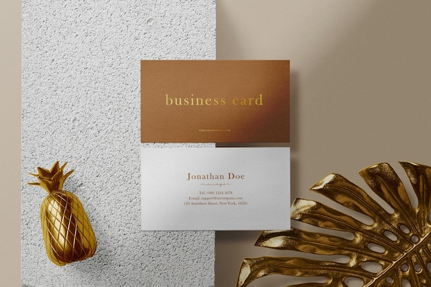 Clean minimal business card mock up on concrete with gold leaf