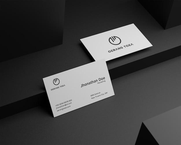 Clean minimal business card mockup on black background