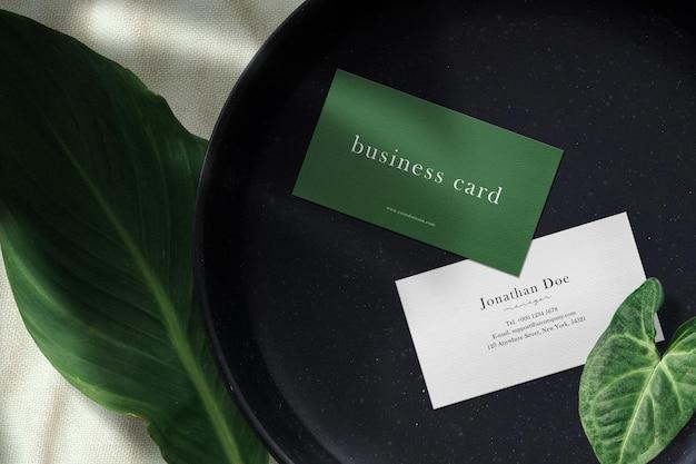Clean minimal business card mockup on black stone plate