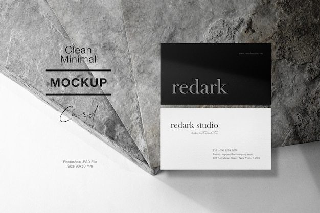 Clean minimal business card mockup on grey stone and light shadow.
