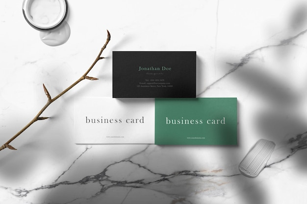 Clean minimal business card mockup on marble surface