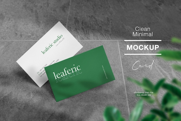 Clean minimal business card mockup on stone floor and light shadow.