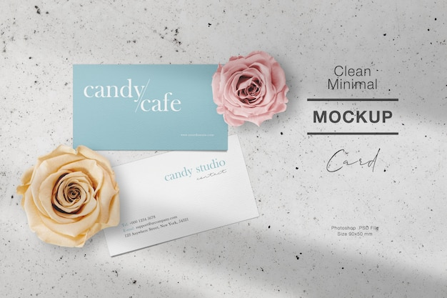 Clean minimal business card mockup on stone with roses and light shadow.